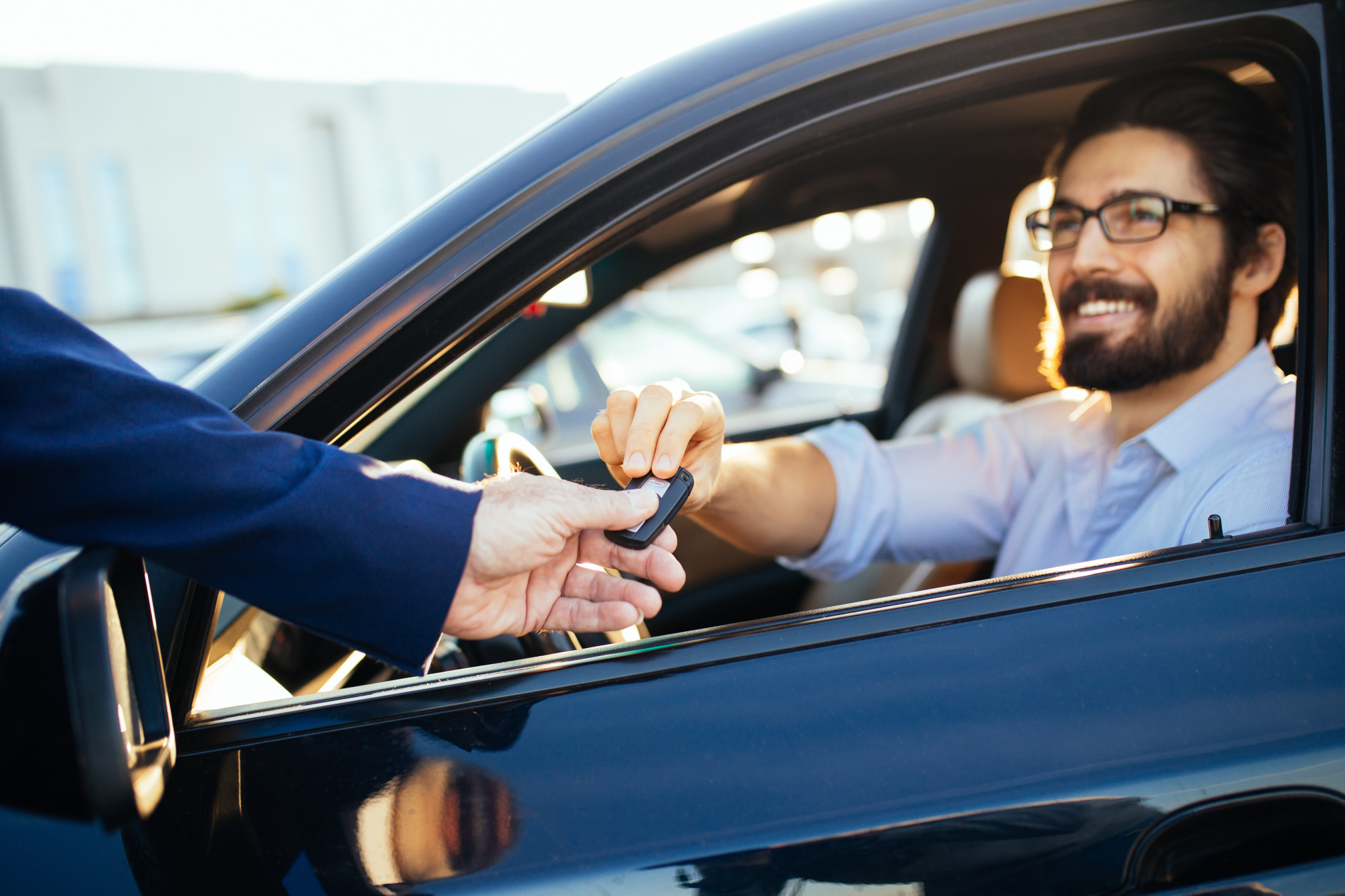 man accepting keys from his car